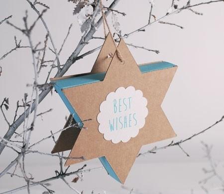 Caja azul y kraft con forma de estrella