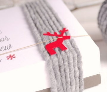 Caja cuadrada decorada con lanas