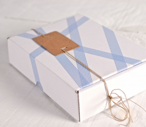 White box decorated with blue squares washi tape