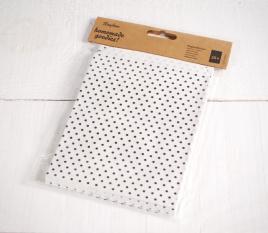 Bolsas de papel blancas con topos negros