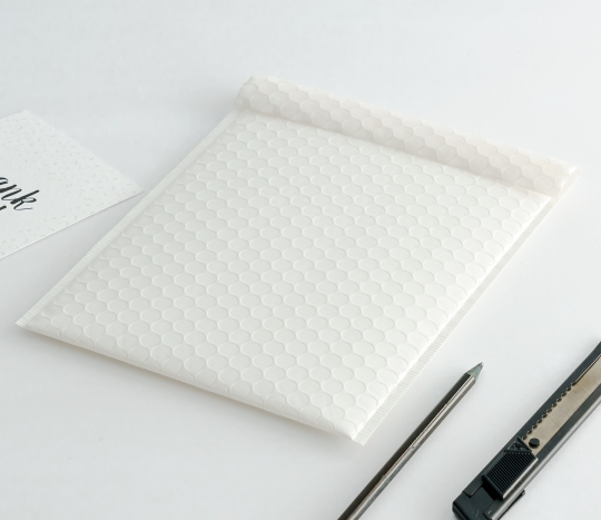 Gloss-finish delivery envelopes.