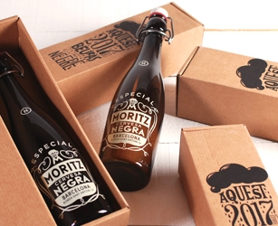 Limited edition presentation pack for Moritz beer. Standard sized delivery box with customised print.